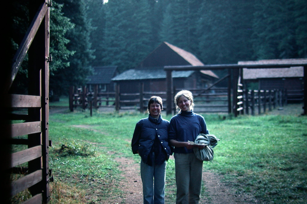 """Here I'm at the Moose Creek Ranger Station, 26 miles up a trail from the end of a long dirt road. The photo shows Carol Holmes and me, at about age 22. We're enjoying our days off from a ten-day trail crew """"hitch"""""""
